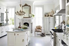 Kitchen in white.  Annie Brahler's Jacksonville, Illinois, home. Interior design by Annie Brahler, owner of Euro Trash.