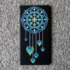 Canvasboard of 2 cm thick painted with acrylic paint with mandala dreamcatcher. The size is 20 x 40 cm. Shipping the painting within 1-3 days with Track & Trace code. Colors on the pictures can deflect from reality. This because every computer has a different color scheme. If you are
