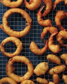 Best Beer Batter from Martha Stewart: Covering onions in buttermilk for at least 30 minutes removes their pungent bite, leaving you with sweet, tender onion rings in a crisp beer-battered shell.