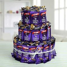 Here you can see that 42 Cadbury Dairy Milk are arranged around three Round Shaped Thermocols to form a three storied chocolate building. You can gift it to your loved ones on any occasion. You just need to make your order from Chocolate Pack, Chocolate World, Chocolate Gifts, Chocolate Lovers, Chocolate Eclairs, Choco Pie, Silk Chocolate, Chocolate Hampers, Best Chocolate