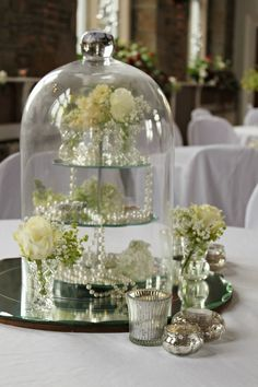 Under glass: Very cool idea, a little 3 tiered display inside the cloche Glass Dome Display, Glass Domes, Glass Jars, The Bell Jar, Bell Jars, Cloche Decor, Wedding Reception Flowers, Deco Floral, Centerpieces