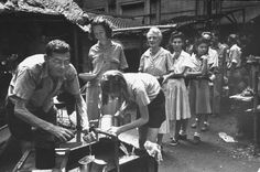 Newly liberated group of American and Filipino civilians getting fresh water in the courtyard of University of Santo Tomas where they had been held captive by the Japanese since Date taken: February Photographer: Carl Mydans. Ww2 Photos, Cool Photos, Interesting Photos, Nagasaki, Hiroshima, University Of Santo Tomas, Stock Pictures, Stock Photos, Iwo Jima