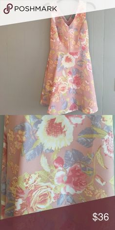 Skies are blue dress size small. Worn once This floral dress is perfect for a wedding or shower. Size small. Only worn once. In brand new condition. Has been dry cleaned. Sits above the knee, under the breast seam and flows throughout the bottom.  Vneck on both front and back of dress skies are blue  Dresses Midi