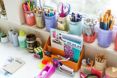 Genius! Use mason jars to keep your pens, pencils, paint brushes and more neat and tidy. To create a coordinated look, use several colors of spray paint to paint the jars. #partner