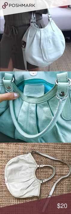 Used Leather Maurizio Tauiti cross body bag! This is a very beautiful Maurizio Taiuti Crossbody  leather handbag cross body purse! COLOR: BABY BLUE (2nd pic) No rips, tears or odors. Very Small stain (2nd pic)I have not tried to take it off. Lots of room for your every day essentials. Great buy of week! Maurizio Taiuti Bags Crossbody Bags