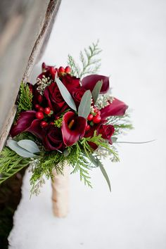 A snowy cranberry-hued holiday mountain wedding at the Stroudsmoor Country Inn // photo by Ashley Bartoletti Photography: http://www.ashleybartoletti.com || see more on http://www.artfullywed.com