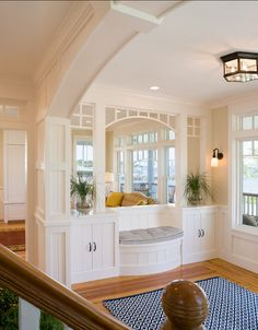 Coastal Foyer Paint Color: The wall color is Ben Moore Carrington Beige HC-93 in eggshell and the trim is Ben Moore Alabaster OC-129 in semi...