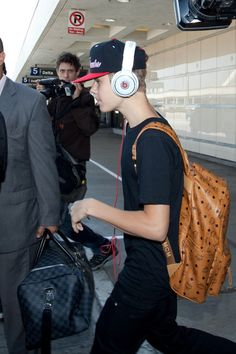 5c777ab3a480 Justin Bieber wearing a drool worthy MCM Backpack.