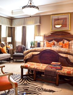 Interiors by Gary Riggs...  Orange is NOT a favorite color of mine, but it looks so warm and cozy in there.  Beautiful.