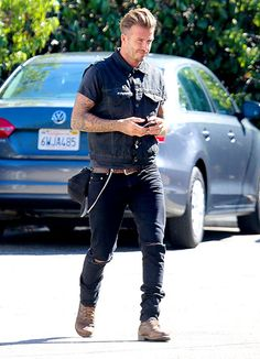 David Beckham was spotted chatting with a fan about his classic motorcycle in Venice. Check out his edgy look!
