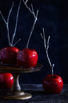 Candied apples are an autumn staple. This version is blood-red and ready to spice up your Halloween, thanks to cinnamon candies.