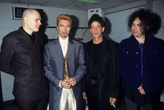 Billy Corgan, David Bowie, Lou Reed and Robert Smith This photo was taken backstage at David Bowie's 50th birthday concert at Madison Square Garden in 1997.