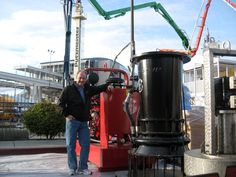 Terry Aylward in Las Vegas March 2014 next to a Griffin Hydraulic Power Unit and 24 inch Axial Flow Water Pump (that's made in the USA).