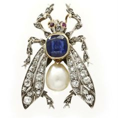 A Victorian sapphire, pearl and diamond fly brooch, the body of a sapphire, weighing 2.35cts in a gold rubover setting, and pear-shaped natural pearl, the wings set with old brilliant-cut diamonds and the legs with rose-cut diamonds, estimated total weight 0.50cts, silver set and mounted on gold, the eyes set with ruby, circa 1870.