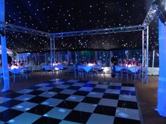 Scaffolding around a dance floor gives a modern funky look for a Dance. http://www.beupstanding.co.uk/gallery.html