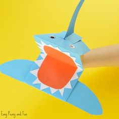 Shark time! Turn you hands into fierce sharks by making a ferocious sharp paper hand puppet! This paper toy is such a fun one, it's always cool to make your own toys don't you think? *this post contains affiliate links* Are you a fan of shark week? We think, while we are also fans of …