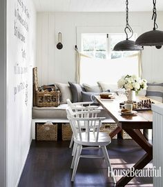 love that wall bench replete with fat pillows and long seat cushion and lots and lots of linen