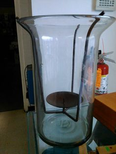 Handblown hurricane shade with iron candle insert