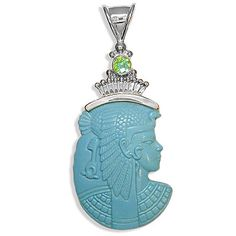 This sterling pendant features a beautiful 35mmx45mm Cleopatra that is hand-carved in Synthetic Turquoise.