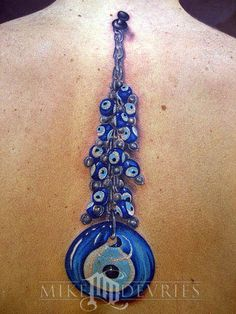 Watch Your Back -- evil eye tattoo
