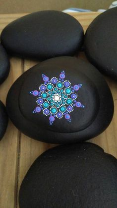 Hand painted purple and turquoise mandala stone.