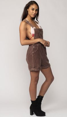 """Vintage 90s overall shorts by No Excuses in brown corduroy with suspender straps and big front pockets. Low sides.  Every item we sell is authentic vintage and one-of-a-kind! You will receive the EXACT item shown in the photos. For reference, model is 5'8"""" and measures 34-24-35. DETAILS  Best fits: marked medium (Note: We only have ONE in stock. If more than one size is listed it is because this item will work on a range of sizes. Check measurements for exact fit.) Condition: great vintage…"""