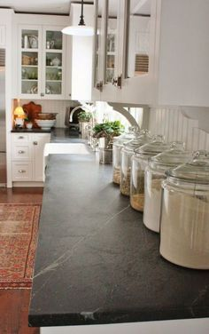 counter tops with paint grade cabinets... Lighter cabinets with dark wood floors would pop your chicken wire accents.