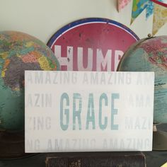 "Limited edition  size Amazing Grace hand painted sign.   Weather worn white with whitewashed grey and robin egg  blue letters.      This sign is  larger then our normal limited edition sign.    11.25"" X 7.25"" X .75"" with a hanger    sign will ship in about two - three weeks.  