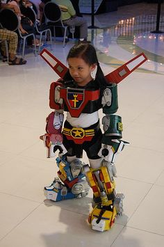 Nothing's cooler than little kids in exceptionally badass costumes, which is why I feel obligated to post this tiny rendition of Voltron for you today. I l