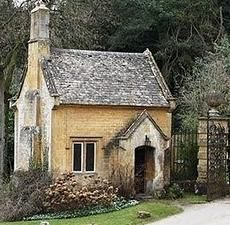 The tiny gatekeeper's cottage pictured sits at the entrance to an English manor house.