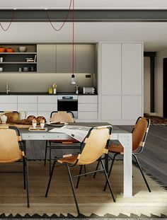 clean, modern kitchen with some industrial details. also, great leather dining chairs