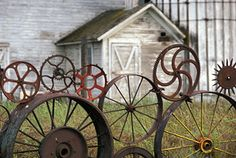 cast iron wheel fence...LOVE
