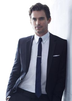 Classic look, neutral colors with very skinny tie and cool tie clip