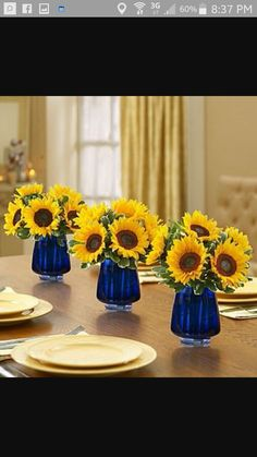 Sunflower Centerpieces in cobalt vases Maybe I could do an arrangement with Sunflowers and Daisies (maybe fake?) in Square glass vases which I can fill with Blue jello. Sunflower Centerpieces, Sunflower Arrangements, Jar Centerpieces, Centerpiece Ideas, Royal Blue Centerpieces, Sunflower Decorations, Turquoise Centerpieces, Wedding Table, Rustic Wedding