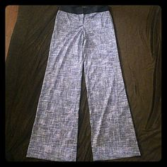 Ann Taylor flair pants Beautiful pants from Ann Taylor. Very light material. Waistband is dark blue and pants itself white with blue. 32.5 inch inseam. New, never been worn! Flare wide leg opening. Size 2 but fits more like 4 as Ann Taylors sizes a little bigger. It's also stretchy. Ann Taylor Pants Wide Leg