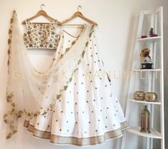 Classy white color lehenga and blouse with embroidery thread work with Geethika Kanumilli. 16 May 2017