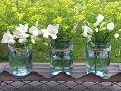 blue jars with random mix of summer flowers would look beautiful throughout the garden and tables at the reception