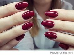 Amazing round gel nails on burgundy