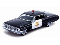 This Ford Galaxie 500 Minneapolis Police (1964) Diecast Model Car is Black and features working steering, wheels and also opening bonnet with engine, boot, doors. It is made by Sun Star and is 1:18 scale (approx. 27cm / 10.6in long).  ...