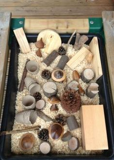Love the use of loose parts in this sensory tub!