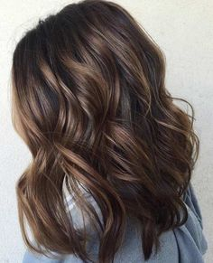 Brown Mid length tousled hair