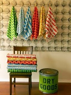 old mattress spring on wall to hang things from - awesome
