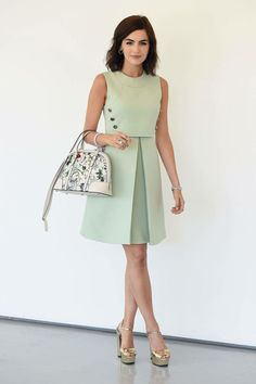 Camilla Belle in a mod-inspired Gucci dress with a Gucci flora bag