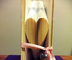 I just absolutely love creating my own folded book art. It's such a fun way of re-using old books and give them another purpose.    I've searched an...