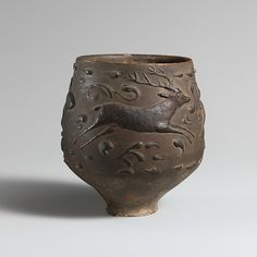 Terracotta cup with barbotine decoration; H. 3 ⅜ in. (8.6 cm) Period: Imperial. Date: 2nd–early 3rd century AD. Culture: Roman. Gallery 169, Metropolitan Museum of Art, NYC