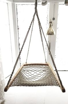 Hanging rope hammock chair, looks fun!