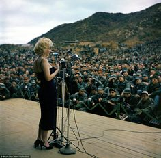 Crowd favorite: Marilyn Monroe entertains the troops in Korea  Read more: http://www.dailymail.co.uk/news/article-2305241/Marilyn-Monroe-Elizabeth-Taylor-Judy-Garland-captured-collection-3-million-photographs-showing-glamor-Old-Hollywood-offered-auction.html#ixzz2PvRgnq1S  Follow us: @MailOnline on Twitter | DailyMail on Facebook