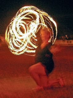 Fire baton twirling at high school half time 59 years old suzeeh