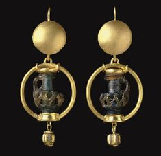 Two miniature Byzantine glass jug pendants, circa to Century A. (I don't care for the jugs, but I like the idea of encirling a focal bead in a ring. Byzantine Jewelry, Renaissance Jewelry, Medieval Jewelry, Byzantine Art, Ancient Jewelry, Roman Jewelry, Old Jewelry, Jewelry Art, Antique Jewelry