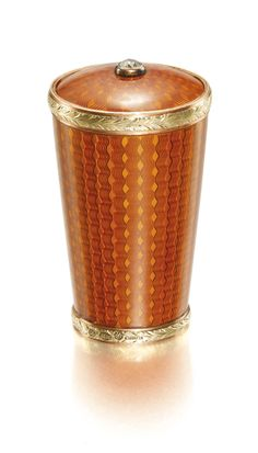A Fabergé jewelled and gold-mounted enamel parasol handle, workmaster Michael Perchin, St Petersburg, 1895-1899 the surface of translucent burnt orange enamel over banded wavy engine-turning within leaf-chased two-colour gold borders, the top set with a circular-cut diamond.